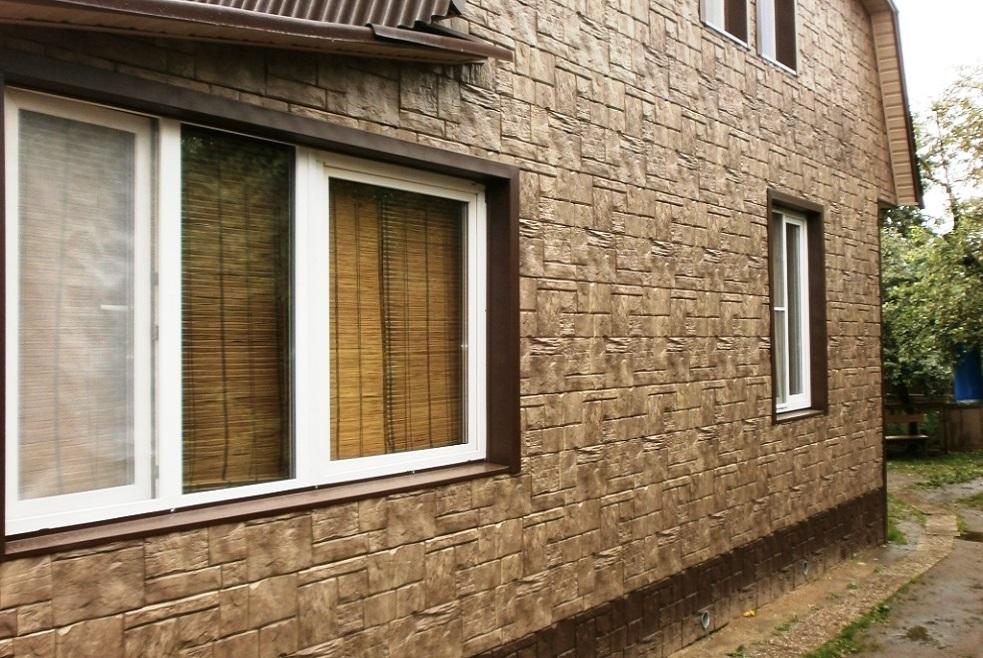 отделка дома снаружи фасадными панелями фото