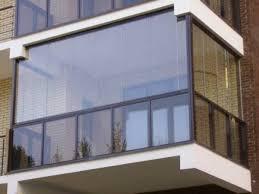 Преимущества безрамного остекления балкона